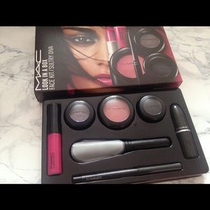 MAC look in box retails for 56.00 . Missing brush